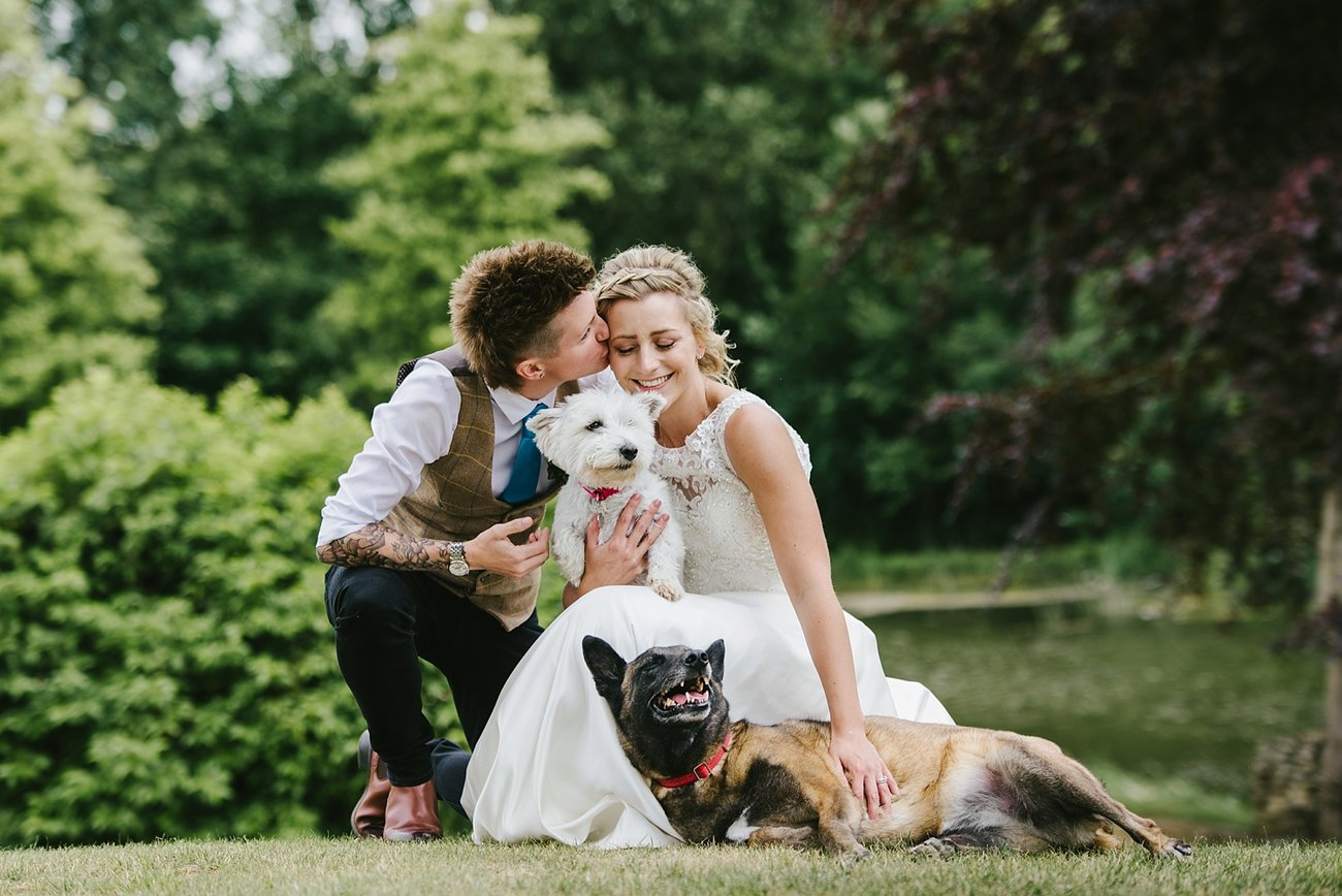 two-brides-with-dogs-at-wedding
